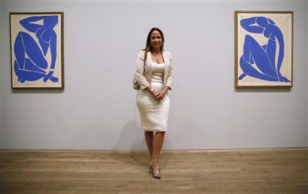 """Sophie Matisse, great-granddaughter of Henri Matisse, poses with two of the artist's famous """"Blue Nude"""" pieces at London's Tate Modern gallery"""